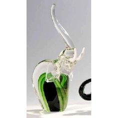 Glass Elephant Sculpture by Womar Glass. $50.39. CM94756 Features: -Material: Fine glass.-Hand blown.-Hand decorated.-Highest quality of workmanship.