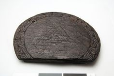 Oseberg Ship grave - Trencher board  Approximately 17cm in diameter. At the center is carved into three triangles intertwined, called Valknuten