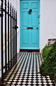 Love the bright blue door against the black/white tile - awesome!