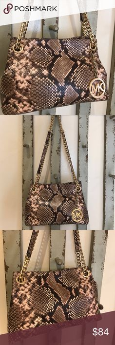 """Michael Kira small python print bag with chain You'll love this little bag from Michael Michael Kors.  Sophisticated python print with double straps in gold chain/python.  Measures about 10 1/2"""" wide, 7"""" tall, and 4"""" deep. Tan logo cloth interior with 2 open pockets, 1 zippered pocket.  Detachable gold logo charm/chain. Impeccable condition.  I am a top-rated seller & ship quickly. MICHAEL Michael Kors Bags Shoulder Bags"""