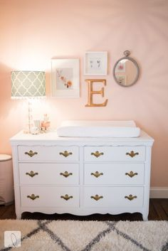 Super sweet changing table in a pink and coral nursery decor.