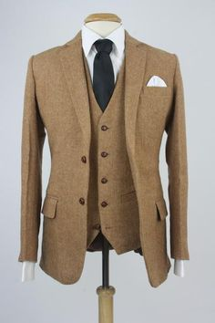 Custom three piece suit features Herringbone pattern Brown 100% soft wool tweed…