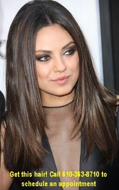 Mila Kunis' straight style is flattering  because long hair creates the illusion   of more length in the face and eliminates width on the sides of the face. To rock a center part as she does, keep long hair with subtle angles in the front, starting at jaw-length or longer.