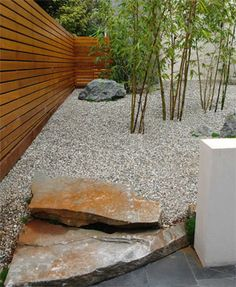 This looks good, but bamboo looks to be buried too deeply, can't see how they will keep the pebbles from seeping toward the base. Trapped moisture can cause canes to become diseased & rot. It would be a shame to lose the plants.