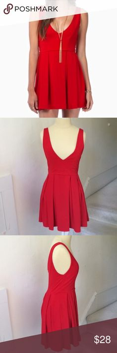 """Tobi Red Deep V Skater Dress EUC Sexy red skater dress from Tobi. Deep plunging V neckline, skater skirt, back zipper. Soft material with some stretch. In excellent pre-loved condition. Approximate measurements: bust 14"""" waist 12 1/2"""" length length from the underarm down is 21"""" fully lined. 95% polyester 5% spandex. A04 * Tobi Dresses Mini"""