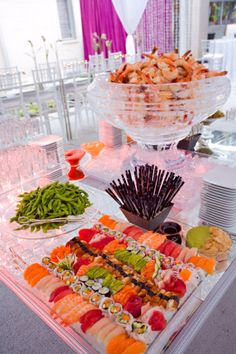 Leslie Rosen Catering created a stylish Seafood Crudite with colorful mixed sushi, salty steamed edamame and a large ice bowl filled with cocktail shrimp.  Photo: Paul Loftland
