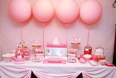 Cake table decor from bellagracepartydesigns. I like that only four round balloons were used, simplicity.