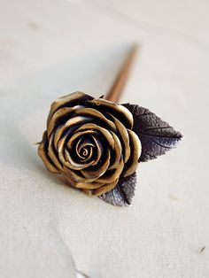 silver and gold wax rose hair stick hair by Joyloveclay on Etsy, $16.00