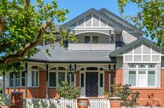 Stucco painted light gray against red brick - Mtg Cal - Tips of paying off Mortgage - House Exterior Color Schemes, House Paint Exterior, Dream House Exterior, Craftsman Bungalow Exterior, Craftsman Bungalows, House Roof, Facade House, Weatherboard House, Edwardian House