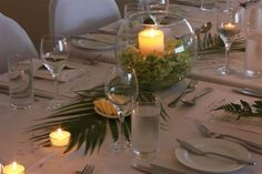 hawaiian table settings | Table setting at night with the candles ablaze - hydrangea and palm ...