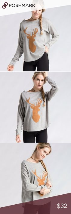 Grey sweater with suede deer patch French Terry sweaters. 65% polyester. 35% cotton. Made in China.   Great for the fall weather and holidays! Fashionomics Sweaters Crew & Scoop Necks