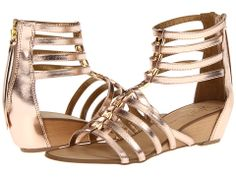 Rose gold low wedges.