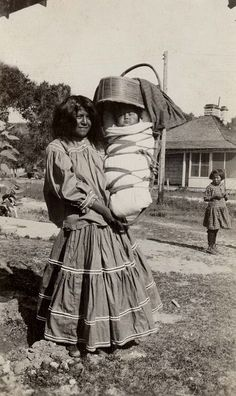 Apache mother with infant, 1931  by Marquette University Archives, via Flickr: