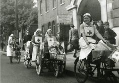 1939-1945. British Red Cross volunteers with bicycles and tricycles outside Hammersmith Red Cross headquarters