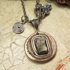 Beautiful pyrite cubes necklace made of raw pyrite cubes stone and polymer clay decorated with silver metallic powder. DANA BROSH special design,