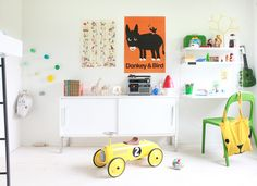 White Kids Room.  It probably wouldn't stay that clean in my house.  I love the yellow car and the lockers though.