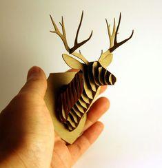 Found at http://amazingminiatures.com/blog/miniature-cardboard-safari-animal-trophy-deer-head-dollhouse/