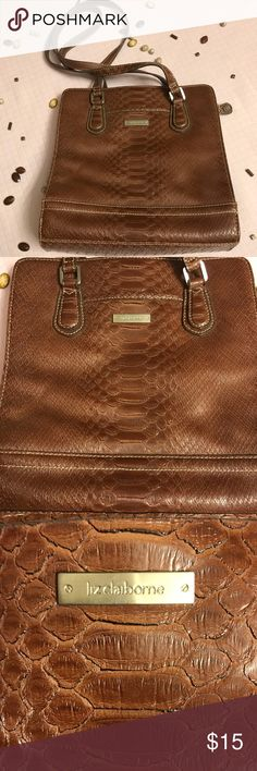 **Host Pick 11/27**Brown Liz Claiborne brown purse Brown Liz Claiborne brown purse in good condition. Only used a couple times.  In great condition.   Dimensions  Length: about 10 inches  Width: about 3 inches  Height: about 10 inches   Prices are always negotiable and bundling is always appreciated and discounted   #lizclaiborne #purse #bag Liz Claiborne Bags Shoulder Bags