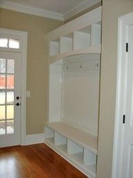 love the shape of this mudroom built in