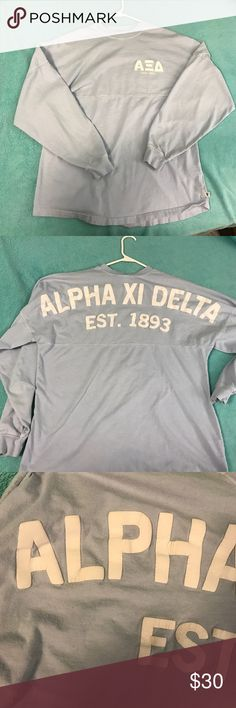 Alpha Xi delta spirit jersey Light wear. Slight cracking on the back letters shown in pictures but no cracking on the front. Light blue color. No stains or damage. Still soft material. Super cute and comfortable. Can fit either a small or a medium! venley Tops Sweatshirts & Hoodies