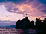 Chillon Castle - The medieval fortress on the shores of Lake Geneva near Montreux is the most visited monument in Switzerland Medieval Fortress, Lake Geneva, I Want To Travel, Most Visited, Resort Spa, Switzerland, Castle, Sunset, Landscape