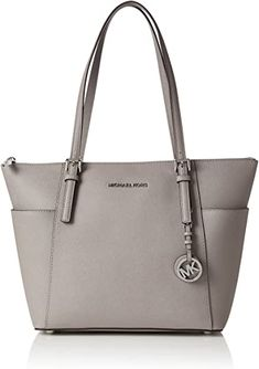 Michael Kors Jet Set East West Top Zip Tote in Pearl Gray Michael Kors Jet Set logo print pearl grey saffiano leather tote with silver-tone hardware. Michael Kors Jet Set, Michael Kors Gray Purse, Michael Kors Tote Bags, Micheal Kors Taschen, Luxury Purses, Best Purses, Medium Tote, Purses And Handbags, Street Style