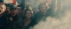 Shot-By-Shot Breakdown Of Avengers 2 Trailer Reveals Spoilery Details:  Cut to Wanda Maximoff (Scarlet Witch) and her brother Pietro (Quicksilver). But they look different, Pietro doesn't have silver hair. He has normal dark hair — is this them pre-powers? Also, what are they at, a protest? A big event? Your guess is as good as mine, because it looks like the whole thing is about to go tits up anyway.