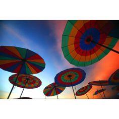 so pretty! striped umbrellas on the beach at sunset