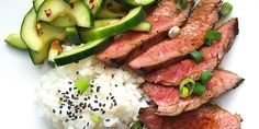 Let this Korean-style flank steak launch your weekend. Get the recipe: Korean-Style Grilled Flank Steak with Sticky Rice and Spicy Cucumber Salad Steak Dinner Recipes, Flank Steak Recipes, Grilled Steak Recipes, Grilling Recipes, Meat Recipes, Asian Recipes, Cooking Recipes, Healthy Recipes, Grilled Meat