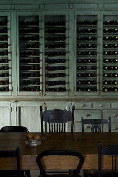 A wall of wine storage.