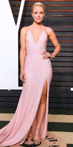 Rachel McAdams went from one plunging gown to another, hitting the Oscars after-party in a deep-V beaded pale pink Naeem Khan design.