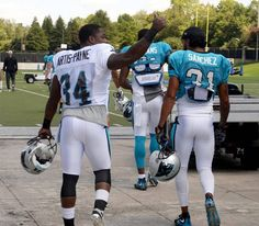 Cameron Artis-Payne gives cheering fans a thumbs up as he arrives for Panthers…