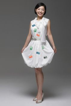 Grab a white dress and adorn it with postage stamps and you'll look first class. Perfect idea for a last minute Halloween costume, a mail-order bride.