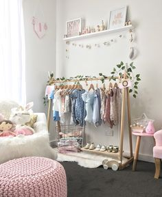 A combination of grey, white, pink and mint with a touch of gold has resulted in this beautifully light and bright nursery for baby Ivy.