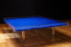 This coffee table is filled with Yves Klein International Blue pigment.  I want it so bad, but could only imagine the clean up if it broke.