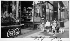 A Japanese family standing in front of their store in Canada, 1933