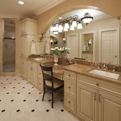 love this big arched mirror and lights on the mirror. traditional bathroom by Meredith Ericksen
