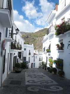 Frigiliana is a mountain town in Andalucia, Spain. A white Andalucian village only 5 miles inland, the village itself is a labyrinth of charming narrow whitewashed streets with old Andalucian houses.