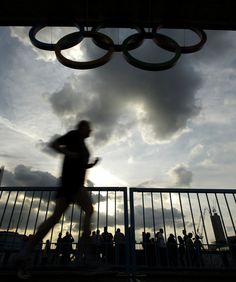 I want to run here!!! A jogger crosses the Tower Bridge below a display of Olympic rings Saturday, July 21, 2012, in London. The opening ceremonies for the 2012 London Olympic Games are scheduled for Friday, July 27. (AP Photo/Charlie Riedel)  CHARLIE RIEDEL - AP