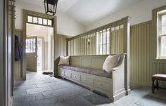 Marthas Vineyard Mudroom with Bench Featuring Hanging Pegs | via Ferguson & Shamamian