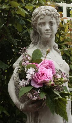Garden statue and roses