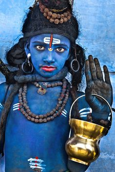 Painted in blue for the festivities at the Pushkar Camel Fair in India. He's dressed like the god Shiva.
