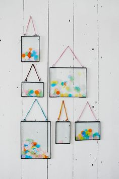 I love these hanging glass frames.