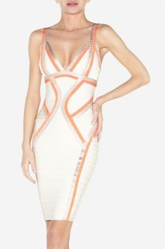 $179.00 V-neck.  Sleeveless. Allover bandage construction with angled contrast trim throughout.  Open back.  Center back zipper with hook-and-eye closure.  Hits above the knee. To maintain the beauty of your garment, please follow the care instructions on the attached label. Rayon, Nylon, Spandex.