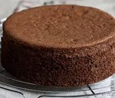 Brushing the cake layers with a simple syrup before frosting keeps the cake from crumbling and drying out. Köstliche Desserts, Delicious Desserts, Yummy Food, Food Cakes, Cupcake Cakes, Cooking Cake, Sponge Cake Recipes, Chocolate Sponge, Brownie Cake