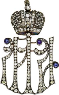 Russian Imperial Diamond Maid of Honor Decoration by Karl Hahn, 1896-1911. Designed as the conjoined initials M A for Dowager Empress Maria Fedorovna and Empress Alexandra Fedorovna, below a Romanov Crown set with diamonds, the scrolling terminals set with sapphires