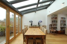 Glass extension, bifold doors and decking. Kitchen Diner Extension, Open Plan Kitchen, Kitchen Extension Roof Windows, Kitchen Extension Into Garden, Bifold Doors Extension, Kitchen Ideas, Style At Home, Glass Extension, Extension Ideas
