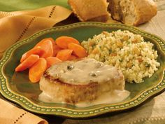 Saucy pork chops simmer in a creamy garlic and mushroom sauce made with Campbell's® Condensed Cream of Mushroom Soup, perfect over rice or couscous.