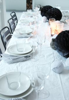 black, white and grey honeycomb balls and textured softly coloured glasses - table centrepiece from the fabulous elisabeth heier: Festbord