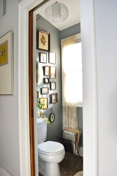 Lauren and Chad's Vintage Comfort - love the grey/blue bathroom. love this frame arrangement...pretty little room, mix modern light with old fashioned decorations, i like the twist.